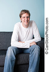 Young man sitting on the sofa