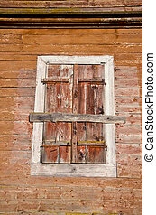 old wooden manor house wall with windows shutter