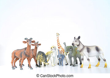 toy animals - various plastic miniature animals on a white...