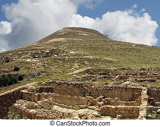 Herodium hill - Herodium or Herodion is a truncated...
