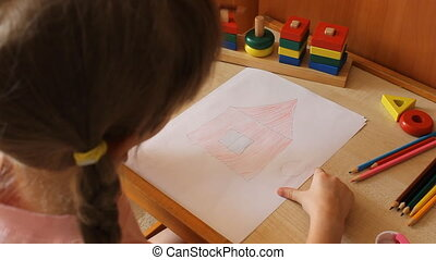 little girl draws a girl near the house 6020