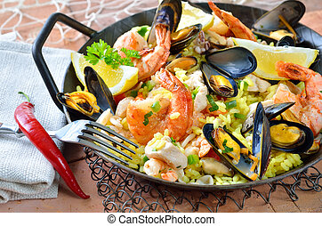 Paella - Tasty Spanish paella with seafood and chicken...
