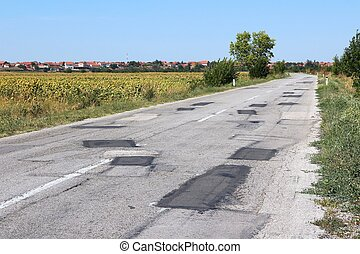 Patched road - Poorly patched road in Negotin, Serbia...