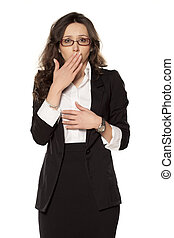 ashamed business woman posing on a white background
