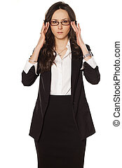 adjusting glasses - nervous business woman adjust her...