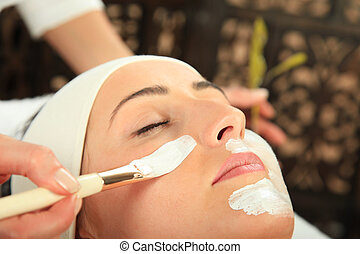 Facial Mask - Young woman receiving mask - SPA