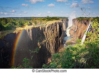 Victoria Falls, Zambia, and rainbow - Victoria Falls,...