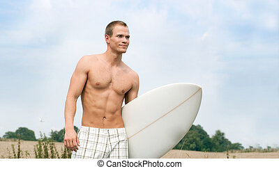 Handsome Surfer on the way to the beach