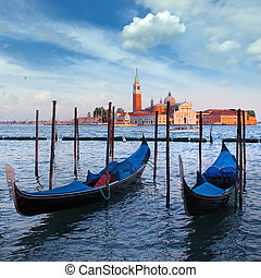 Gondolas and San Giorgio Maggiore church on Grand Canal in...