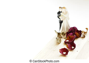 Groom and bride, rose petals and hearts