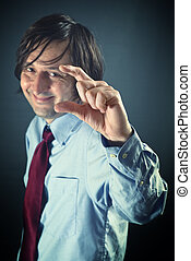 That is small - Smiling businessman is mocking, showing a...