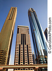 DUBAI, UAE - OCTOBER 23: View at Sheikh Zayed Road skyscrapers in Dubai on October 23, 2012. More than 25 skyscrapers taller than 100 meters can be found here.