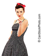Woman in Pin-up style on white background pointing at you