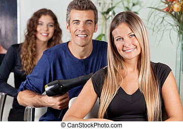 Team Of Hairdressers At Beauty Parlor - Portrait of...