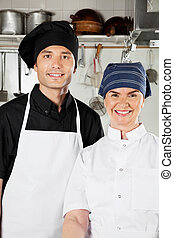 Happy Chefs In Industrial Kitchen - Portrait of happy chefs...