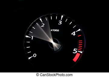rev meter - moving revs meter of a sports car on a black...