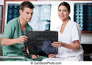 Medical Technicians Analyzing MRI X-ray - Medical...