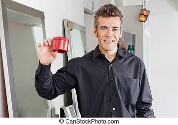 Happy Hairstylist Showing Hairgel Bottle
