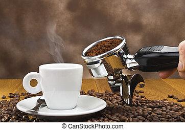 An espresso machine group head with fresh ground coffee