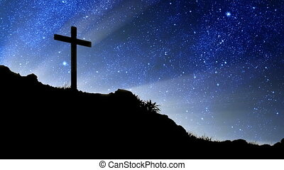Stars Behind Cross - The heavens spinning behind a...