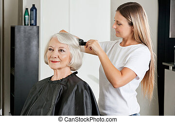 Client Having Hair Straightened By Hairstylist - Female...