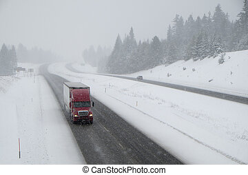 Dangerous driving, snow-covered interstate highway -...
