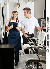 Hairstylist's In Beauty Parlor - Hairstylist's with combs...