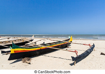 Malagasy outrigger canoes - Fishing canoes on the beach of...