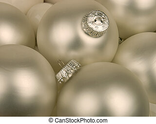 Silver christmas ornaments - close-up of silvery white...