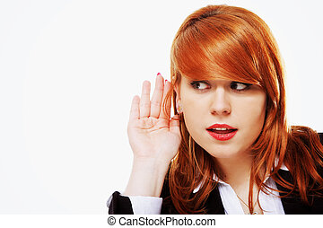 Business woman with hand to ear listening isolated -...