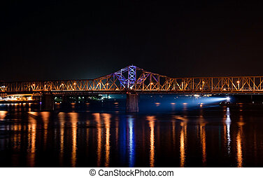 River traffic - A barge navigates the Ohio River at night in...