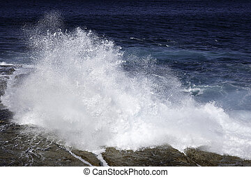 ocean waves crashing on rocks - ocean waves crashing against...