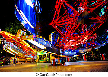 Motion of lights - terrific speed of carousel in evening...