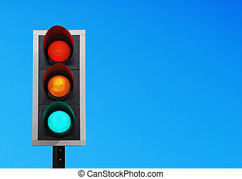 Traffic lights - traffic lights against a vibrant blue sky...