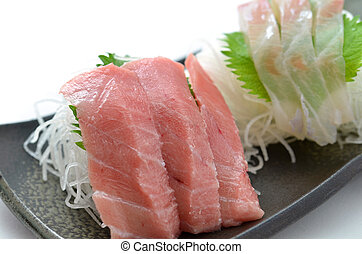 Sliced raw fish called Sashimi - This is a picture of...
