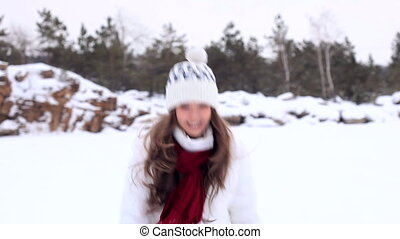 Winter Girl Snowball - Beautiful girl in winter clothes...