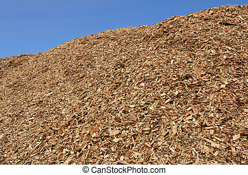 Pile of Woodchip against Blue Sky - Pile of woodchip against...