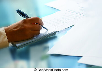 write in note - businessman hand write message in the note