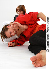 women fighting martial arts over white background