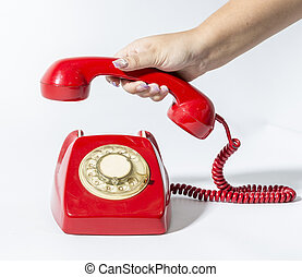 picking up a phone - a hand is picking a red phone old