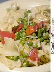 noodles with green peas red pepper pieces and garlic butter