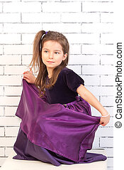 child in a purple dress