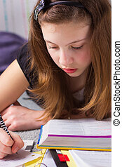 Homework Girl - Cute young teenage girl with school books...