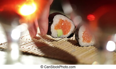 Sushi rolls and plum wine. Beautiful shallow dof.