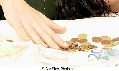 Unhappy woman counting money - Young woman with debts...