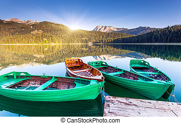 lake - Reflection in water of mountain lakes and boats....