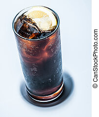 Cola in Glass with ice and Lemon