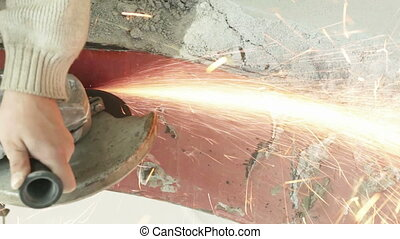 Angle grinder cut metal. Electric saw to cut a piece of the...