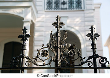 Iron Fence - an iron fence in front of an antebellum mansion...