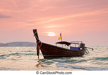 Longtail boats against a sunset Ao-Nang, Thailand